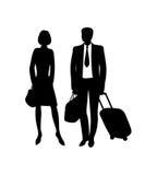 Homme et femme avec la valise et les sacs Photo libre de droits