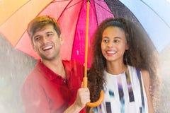Homme et femme avec le parapluie Photographie stock