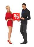 Homme et femme avec le signe de pour cent Photographie stock libre de droits