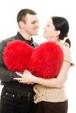 Homme et femme avec un coeur dans des ses mains Photos libres de droits