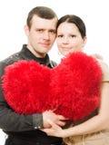 Homme et femme avec un coeur dans des ses mains Image libre de droits