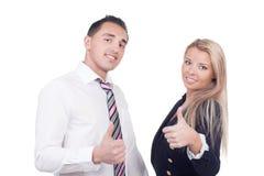Homme et femme d'affaires montrant des pouces  Photo stock