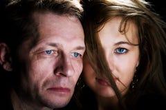 Homme et femme d'isolement sur le noir Image libre de droits