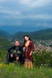 Homme et femme dans la robe nationale géorgienne Photographie stock