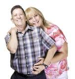 Homme et femme de sourire de transsexuel posant la fin ensemble Image stock