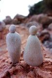 Homme et femme en pierre de couples Photos libres de droits