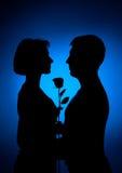 Homme et femme et fleur Images stock