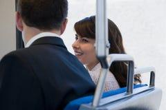 Homme et femme sur le train Images stock