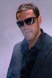 Homme et fumée Image stock