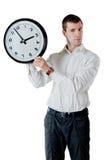 Homme et horloge Photographie stock