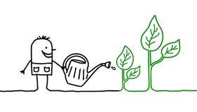 Homme et jardinage Photographie stock libre de droits