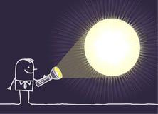 Homme et lampe-torche Photo stock