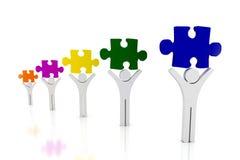 Homme et puzzles Photos stock