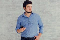 Homme et téléphone Photo stock