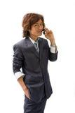 Homme et téléphone asiatiques d'affaires Photographie stock