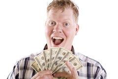 Homme excité au sujet de l'argent Image libre de droits