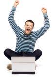 Homme Excited avec l'ordinateur portatif Image libre de droits