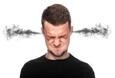 Homme fâché avec de la fumée sortant de ses oreilles Image libre de droits
