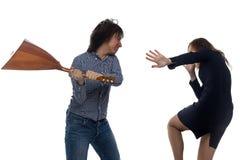 Homme fâché avec la balalaïka et la femme Image libre de droits