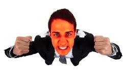 Homme fâché d'affaires avec le visage éclatant rouge Image libre de droits