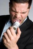 Homme fâché de téléphone Photo stock