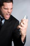 Homme fâché de téléphone Images libres de droits