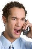 Homme fâché de téléphone Images stock