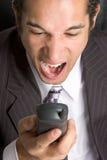 Homme fâché de téléphone image libre de droits