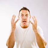 Homme faisant des gestes dans la surprise Photographie stock libre de droits