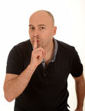 Homme faisant des gestes pour tranquille Photos stock
