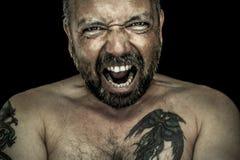 Homme fâché avec la barbe Photographie stock libre de droits