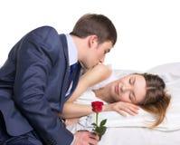 Homme, femme et rose de rouge Photographie stock