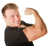 Homme fléchissant le biceps Photographie stock libre de droits
