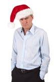 Homme grincheux fumiste de Bah dans le chapeau de Santa Image libre de droits