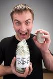 Homme heureux avec de l'argent en boîte Photographie stock libre de droits
