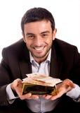 Homme heureux d'affaires avec une barre et des billets de banque d'or Images stock