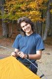 Homme heureux dans le camp Photographie stock libre de droits