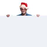 Homme heureux de Santa présent le grand conseil vide Photo stock
