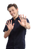 Homme heureux rejetant et faisant des gestes l'arrêt avec des mains Photographie stock
