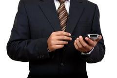Homme indien d'affaires utilisant le pda (2) Image stock