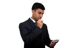 Homme indien d'affaires utilisant le pda (4) Photo libre de droits
