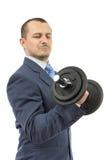 Homme intense d'affaires avec l'haltère image stock