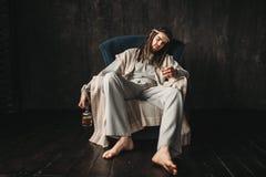 Homme ivre dans l'image de Jesus Christ Image stock