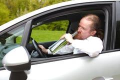 Homme ivre dans la voiture Photographie stock libre de droits