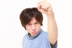 Homme japonais dans une pose de victoire Photos stock