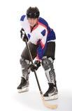Homme jouant à l'hockey Photographie stock libre de droits