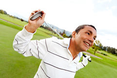 Homme jouant au golf Photo libre de droits