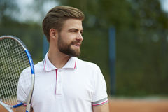 Homme jouant au tennis Photo stock