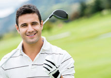 Homme jouant le golf Photo libre de droits