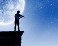 Homme jouant le violon Image stock